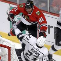 Checkmate: Blackhawks winger Marian Hossa checks the Kings' Dominc Brown during Chicago's 3-1 win on Sunday. | AP