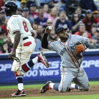 Turning two: San Francisco third baseman Pablo Sandoval starts a double play against Atlanta in the second inning on Saturday night. The Giants beat the Braves 3-1. | AP