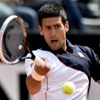 Back in action: Novak Djokovic hits a shot during his 6-3, 7-5 win over Radek Stepanek in Rome on Tuesday. | AFP-JIJI