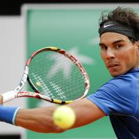 Nadal battles into quarters