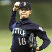 Back in action: Seattle's Hisashi Iwakuma throws a pitch against Houston in the first inning on Saturday night. The Mariners outslugged the Astros 9-8. | KYODO