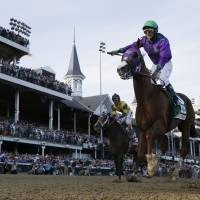 Run for the roses: California Chrome and jockey Victor Espinoza win the Kentucky Derby at Churchill Downs in Louisville, Kentucky, on Saturday in the 140th edition of the classic. | AP