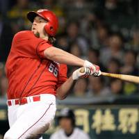 Swing for the fences: Carp outfielder Brad Eldred has gotten off to a hot start for the first-place Carp this season. Eldred is hitting .370 and leads Japan with 39 RBIs. | KYODO