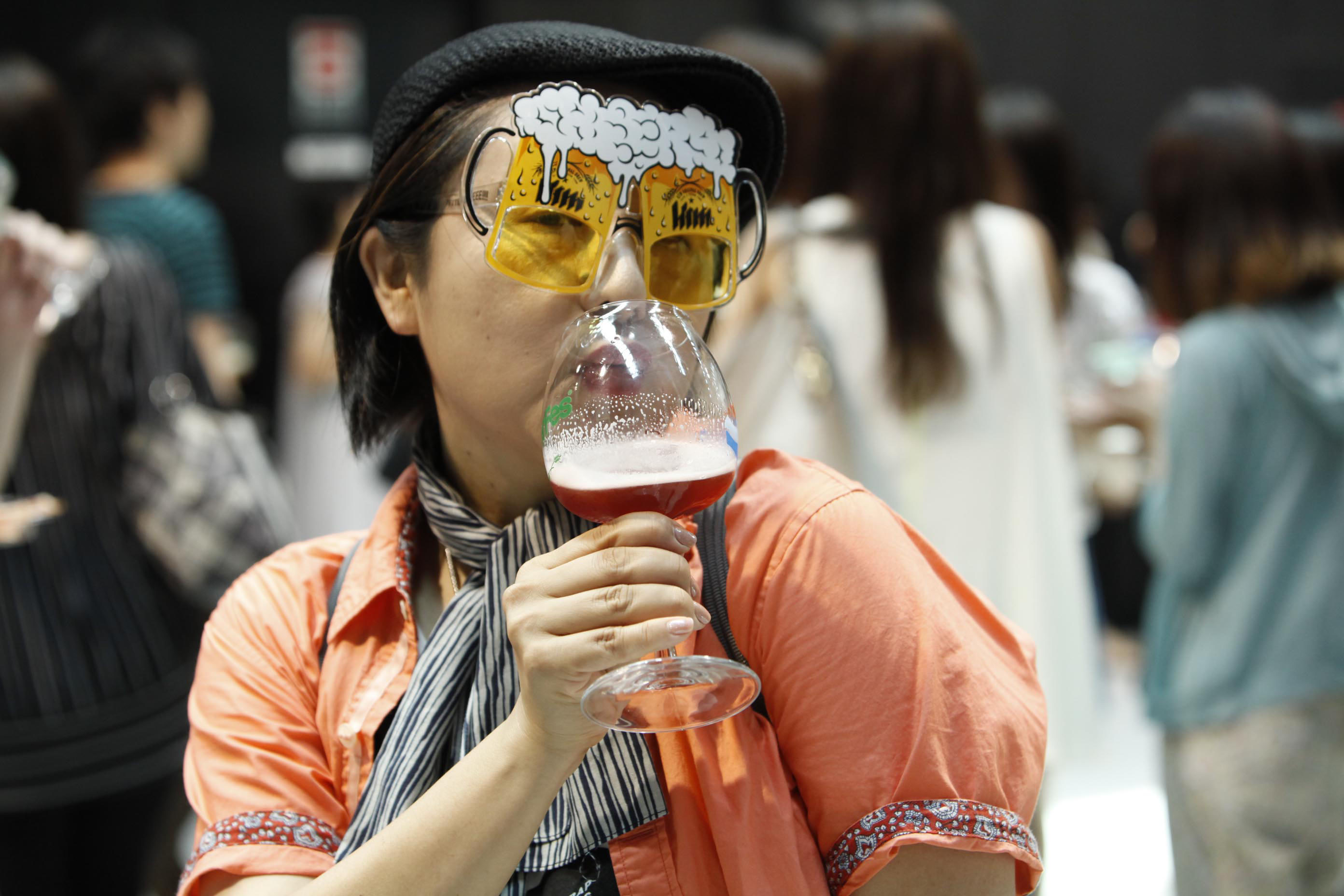 Beer googles: A woman drinks craft beer at a festival in Osaka in July 2013.