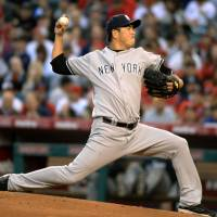 Kuroda solid on mound as Yankees edge Angels on late HR