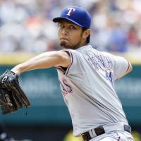Strikes out six: Texas starter Yu Darvish throws a pitch against Detroit in the first inning on Thursday afternoon. | REUTERS