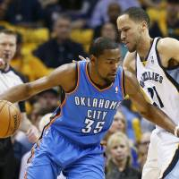 Comes up big: Oklahoma City's Kevin Durant drives around Memphis' Tayshaun Prince in Game 6 on Thursday night. | AP