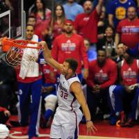Throwing down: Los Angeles' Blake Griffin dunks against Golden State in Game 7 on Saturday night at Staples Center. | AP