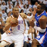 Talk to the hand: Oklahoma City's Russell Westbrook drives against Los Angeles' Glen Davis during the fourth quarter of the Thunder's 105-104 win on Tuesday. | USA TODAY/REUTERS