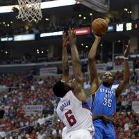High release: Oklahoma City's Kevin Durant puts up a jumper over Los Angeles' DeAndre Jordan in the first quarter in Game 6 on Thursday night at Staples Center. The Thunder beat the Clippers 104-98 to take the series 4-2. | REUTERS