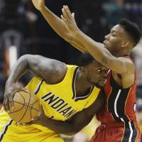 Up close and personal: The Pacers' Lance Stephenson (left) is guarded by the Heat's Norris Cole on Sunday. | AP