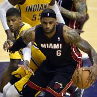 LeBron, Wade dig Heat out of hole to even series at 1-1