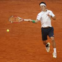 Full throttle: Kei Nishikori plays a shot from David Ferrer in their semifinal match at the Madrid Open on Saturday. | AP