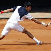 Djokovic battles past Raonic, to meet Nadal in Rome final
