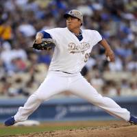 Clean slate through seven: Los Angeles starter Ryu Hyun-jin fires a pitch against Cincinnati in the fourth inning on Monday.   AP