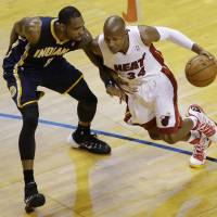 Contact sport: Miami's Ray Allen drives on Indiana's Rasual Butler in the first half of Game 4 on Monday night. The Heat beat the Pacers 102-90 and lead the series 3-1. | AP