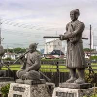 Stone statues of the 47 ronin line the entrance to Oishi Shrine in Ako. | ALON ADIKA