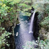 Rowboats ply the waters beside Manai Waterfall in the narrowest part of Takachiho Gorge. | MANDY BARTOK