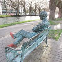 Silence is golden: A bronze depiction of acclaimed poet Patrick Kavanagh sits by the Grand Canal in Dublin in March. | AP