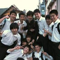 Students from Seijo High School breeze home at the end of their school day. | KIT NAGAMURA