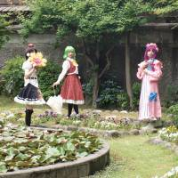 Men engaging in 'cosplay' pose during a photo shoot last year in a European-style garden in Minamiechizen, Fukui Prefecture. The hobbyists, both male and female, enjoy dressing up as other-worldly characters inspired by cartoon culture. | MINAMIECHIZEN MUNICIPAL GOVERNMENT/KYODO