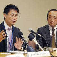 Hiroshima Gov. Hidehiko Yuzaki (left) answers questions at the U.N. headquarters in New York on Wednesday, as Hiroshima Mayor Kazumi Matsui looks on. | KYODO