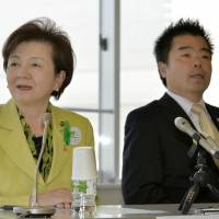 Shiga Gov. Yukiko Kada speaks at a meeting in the prefecture's capital, Otsu, on Wednesday, alongside Democratic Party of Japan lawmaker Taizo Mikazuki. | KYODO