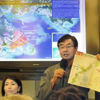 Susumu Inamine, mayor of Nago, Okinawa Prefecture, addresses a gathering in New York on Saturday. | KYODO