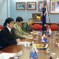 Defense Minister Itsunori Onodera (left) holds talks with Australian counterpart David Johnston (far right) in Perth, Australia on April 28. | KYODO