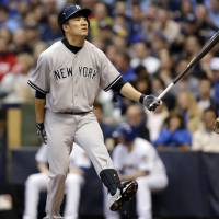 Don't quit your day job: The Yankees' Masahiro Tanaka strikes out against the Brewers on Friday in Milwaukee. New York won the game 5-3. | AP
