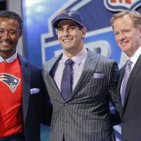 For the future: Jimmy Garoppolo (center) poses with former Patriots great Willie McGinest (left) and NFL commissioner Roger Goodell on Friday. | AP
