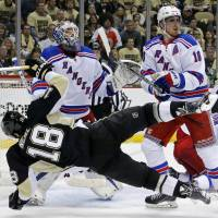 Brassard strikes in OT to lift Rangers