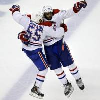 Last laugh: P.K. Subban (right) and Francis Boullion celebrate a goal. | AP