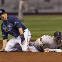 High impact: Tampa Bay's David DeJesus (left) breaks up a double play after upending Boston's Dustin Pedroia during the Rays' 1-0 win on Friday. | AP