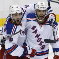 Rangers win to stave off elimination