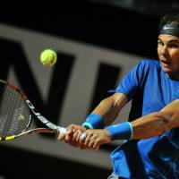 Nadal mounts rally to defeat Murray