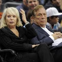 Not without a fight: Clippers owner Donald Sterling (right) filed a lawsuit against the NBA seeking over $1 billion on the same day it was learned his wife Shelly (left) planned to sell the team. | AP