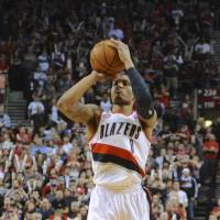 We're done here: The Trail Blazers' Damian Lillard shoots a game-winning 3-pointer to give Portland a 99-98 triumph over the Rockets on Friday night. The Blazers clinched the first-round playoff series 4-2 with the victory. | AP