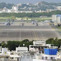 Helicopters and transport planes sit on the tarmac at U.S. Marine Corps Air Station Futenma in the city of Ginowan, Okinawa Prefecture, in May 2012. | KYODO