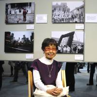 Tsuneko Sasamoto poses at her photo exhibition in the Japan Newspaper Museum, Yokohama, on April 5. | SATOKO KAWASAKI