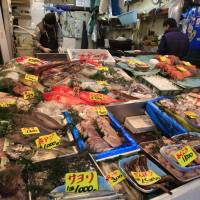 Fish products are displayed at a shop near the Tsukiji market in Tokyo's Chuo Ward in March 2011. Waning domestic demand is prompting fish traders to learn the ins and outs of the export business to target fresh markets abroad. | AP