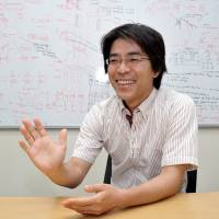 Junichi Yamagishi, associate professor at the National Institute of Informatics, explains how voices can be synthesized, at his office in Tokyo on May 12. | YOSHIAKI MIURA
