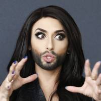 Drag queen Conchita Wurst, who will take to the European stage as Austria's contender for the Eurovision song contest, is interviewed in Vienna on April 24. | REUTERS