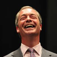 U.K. Independence Party leader Nigel Farage reacts on stage after hearing European parliamentary election results in Southampton, England, on Monday. | AP, AFP-JIJI