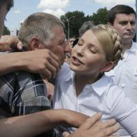 Presidential candidate Yulia Tymoshenko is welcomed by supporters at an election campaign rally held on Thursday in Priluki, northeast Ukraine. | AP
