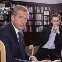 'NBC Nightly News' anchor Brian Williams (left) is seen at an interview shoot with U.S. secrets leaker Edward Snowden in Moscow. | REUTERS