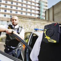 A London policeman wears a body video camera.  | REUTERS