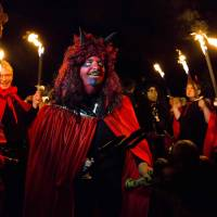 A man in a devil costume acts as the master of ceremony at a Walpurgisnacht pagan festival in the town of Stiege, in Germany's Harz mountain region, on Friday. | REUTERS