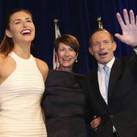 Abbott apologizes for 'winking' at Aussie sex worker