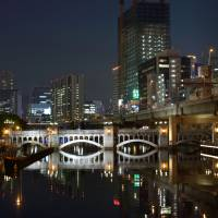 The Osaka skyline glows over the city's Nakanoshima district on May 2. | BLOOMBERG